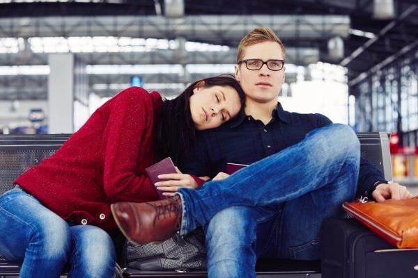 Couple waiting for flight at the airport