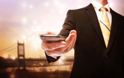 Business man with mobile phone on a bridge background
