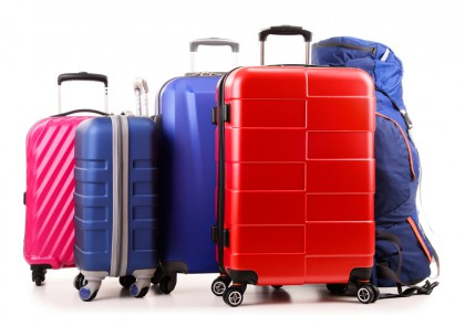 Luggage consisting of large suitcases and rucksack isolated on white.
